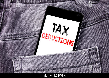 Conceptual hand writing text caption showing Tax Deductions. Business concept for Finance Incoming Tax Money Deduction written mobile cell phone with copy space in the back pants trousers pocket - Stock Photo