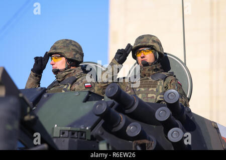BUCHAREST, ROMANIA - December 1, 2018: Polish soldiers in a ROSOMAK armored vehicle at Romanian National Day military parade - Stock Photo