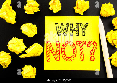 Handwritten text showing Why Not Question. Business concept writing for Leadership Motivation written on sticky note paper on the black background. Folded yellow papers on the background - Stock Photo