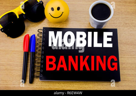 Conceptual hand writing text caption showing Mobile Banking. Business concept for Internet Banking e-bank written on sticky note with space on old wood wooden background with sunglasses - Stock Photo
