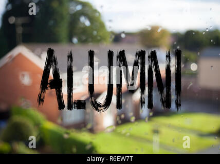 Announcement text caption showing Alumni Former Students. Business concept for Celebration Education Ending written on old brick background with copy space - Stock Photo