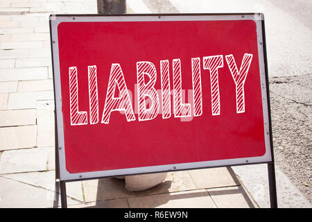 Conceptual hand writing text caption inspiration showing Liability. Business concept for Accountability Legal Blame Risk written on announcement road sign with background and copy space - Stock Photo