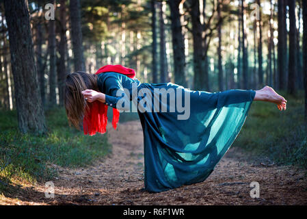 Beautiful, young woman levitating in woods. Flying in the dream. Lack of gravity. Concept of magic, wonderland and fairy tale in forest. - Stock Photo