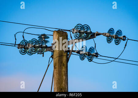 Electrical pole, with glass insulators. - Stock Photo