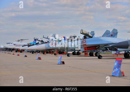 MOSCOW, RUSSIA - AUG 2015: Sukhoi fighter aircrafts presented at the 12th MAKS-2015 International Aviation and Space Show on August 28, 2015 in Moscow - Stock Photo