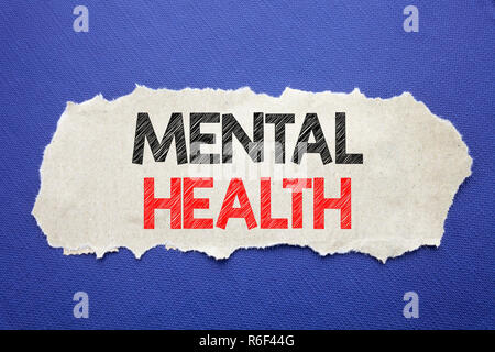 Handwriting Announcement text showing Mental Health. Business concept for Anxiety Illness Disorder Written on note paper with black background with space. - Stock Photo