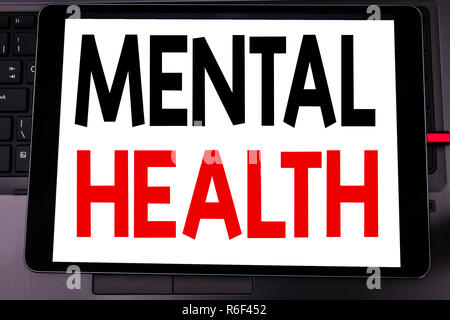 Conceptual hand writing text caption inspiration showing Mental Health. Business concept for Anxiety Illness Disorder written on tablet laptop on the black keyboard background. - Stock Photo