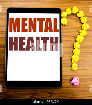 Handwriting Announcement text showing Mental Health. Business concept for Anxiety Illness Disorder Written on tablet with wooden background in the office table. - Stock Photo