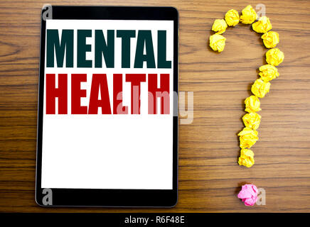 Word, writing Mental Health. Business concept for Anxiety Illness Disorder Written on tablet, wooden background with question mark on the end. - Stock Photo