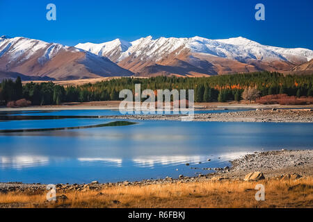 Stunning landscape views of Southern Alps and Lake Tekapo - Stock Photo