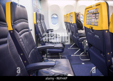 The new Boeing Sky Interior cabin of Ryanair. the aircraft is a Boeing 737-800 specifically a Boeing 737 Next Gen or 737-8AS(WL) with registration EI-FZL. Ryanair is a low cost carrier based in Dublin Airport, Ireland. - Stock Photo