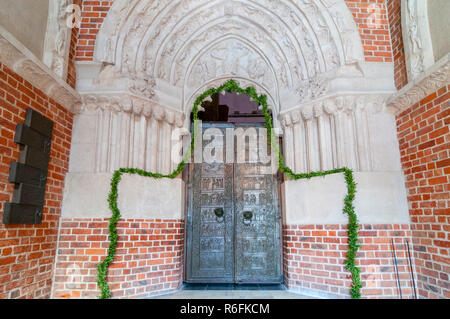 The Pair Of Romanesque Bronze Doors From Around 1175 At Gniezno Cathedral The Doors Depict, In Bas-Relief 18 Scenes From The Life Of St Adalbert, Pola - Stock Photo