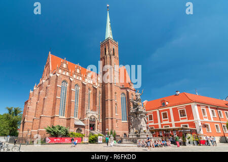 Church Of The Holy Cross And St Bartholomew And Statue Of John Of Nepomuk In Wroclaw, Poland - Stock Photo