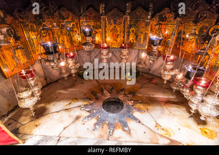 A Silver Star Marks The Traditional Site Of The Birth Of Jesus In A Grotto Underneath Bethlehem'S Church Of The Nativity, Palestine - Stock Photo