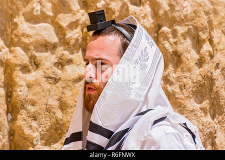 Ultra Orthodox Jew Wrapped With Traditional Religious Talit Shawl And Tefillin Phylacteries At Prayer In The Western Wall Old City, East Jerusalem, Is - Stock Photo