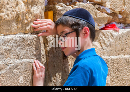 Young Boy Praying At The Western Wall In Jerusalem Old City, Israel - Stock Photo
