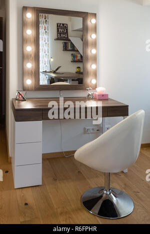 Interior of the bedroom for girls with boudoir table - Stock Photo