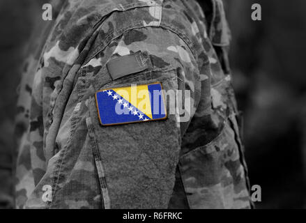 Flag of Bosnia and Herzegovina on soldiers arm (collage). - Stock Photo