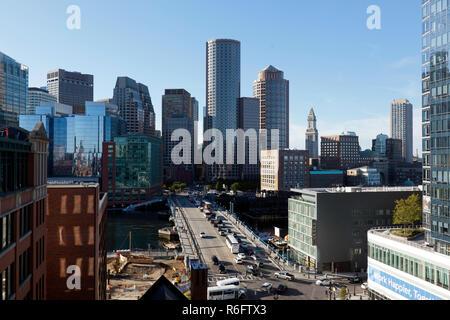 Aerial view of Boston skyline and the Seaport boulevard bridge Massachusetts USA - Stock Photo