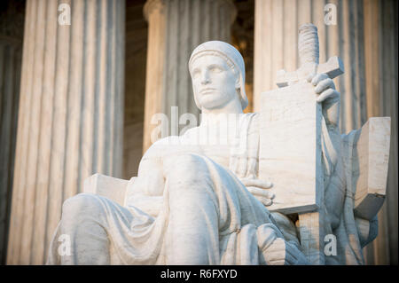Authority of Law statue at the neoclassical columned entrance to the US Supreme Court building in Washington DC - Stock Photo
