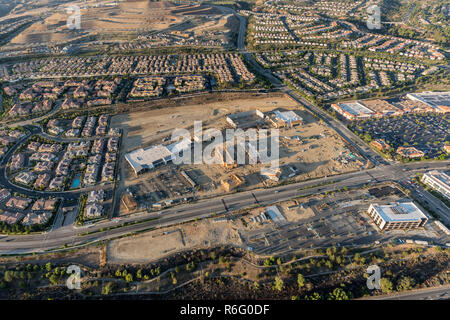 Aerial late afternoon view of homes, shopping center construction and Rinaldi Street in the fast growing Porter Ranch neighborhood of Los Angeles, Cal - Stock Photo
