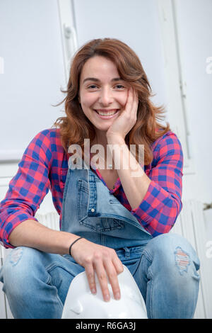 portrait of young engineer woman with safety hard hat - Stock Photo