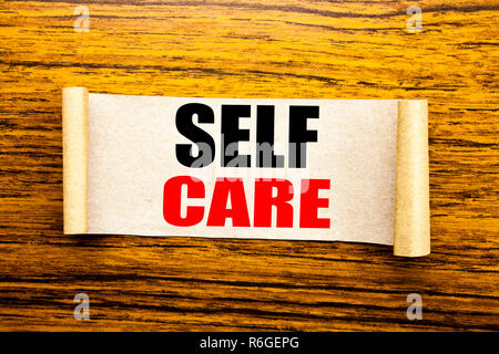 Hand writing text caption inspiration showing Self Care. Business concept for Taking caring for own Health written on sticky note paper on the wooden background. - Stock Photo