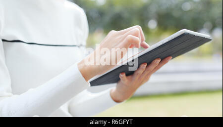 Woman working on tablet computer - Stock Photo