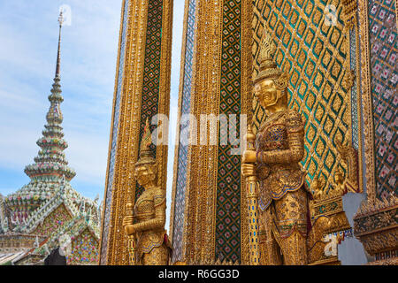 Golden Yaksha statue in the Grand Palace in Bangkok, Thailand. The demon-gods statues are a common sight in Buddhist temples in Thailand, but also fea - Stock Photo