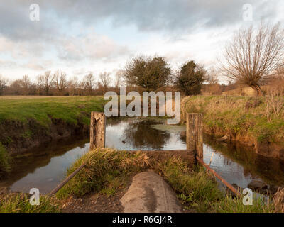 wet waterlogged country farm land stream eddy - Stock Photo