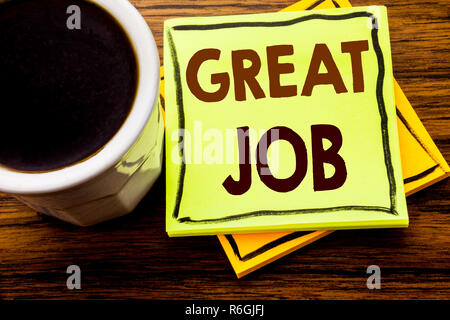 Handwritten text showing Great Job. Business concept for Success Appreciation written on sticky note paper on the wooden wood background with coffee cup - Stock Photo