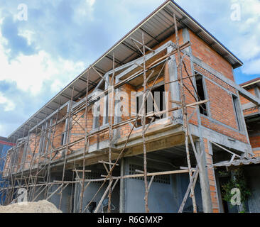 House under construction, commercial building in Thailand - Stock Photo