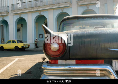 American and Russian classic car parked on central square in Cienfuegos, Cuba - Stock Photo