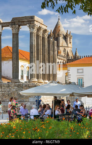 Templo Romano dating from the 2nd century AD and the Quiosque Jardim Diana cafe with the Se behind in afternoon sun, Evora, Alentejo, Portugal, Europe - Stock Photo