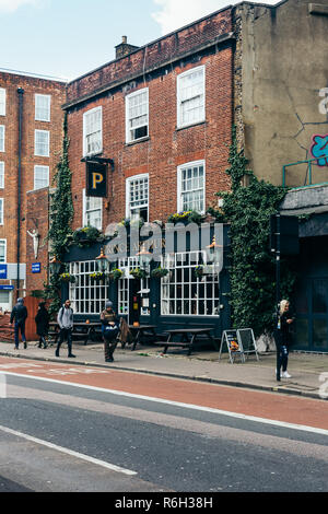 London/UK - March 25 2018: Londoners passing by The Prince Arthur Pub on the Eversholt Street in London, UK. Pubs are relaxed, social drinking establi - Stock Photo