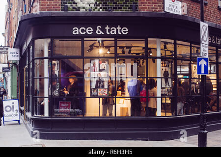 London, UK / March 11 2018: customers in Ace and Tate eyewear shop on the corner between Tower Street and Earlham Street in Borough of Camden, London, - Stock Photo
