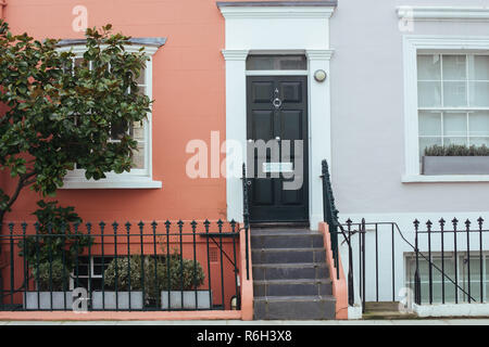 London, UK - March 11, 2018: Facades of typical colorful terraced houses in Notting Hill - Stock Photo