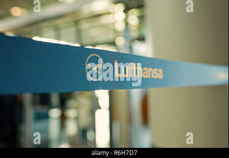 Frankfurt am Main, Germany - October 11, 2015: Lufthansa icon or logo sign on blue tape or ribbon with airlines symbol on blurred background - Stock Photo