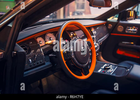 Close up Luxury convertible car interior. Steering wheel, shift lever and dashboard. Driver side view. Selective focus, copy space - Stock Photo