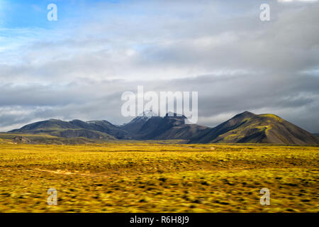 Highlands of Iceland concept. Haukadalur valley in Iceland. Beautiful landscape in valley. Peaceful nature environment. Valley landscape sunny autumn day cloudy sky. Amazing beauty of valley. - Stock Photo