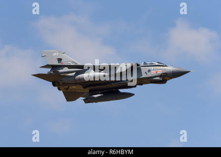 Royal Air Force RAF Panavia Tornado GR4 jet fighter bomber plane flying at Royal International Air Tattoo, RIAT, RAF Fairford airshow. Fast. Speed - Stock Photo