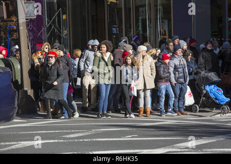 Crowds of people out shopping on a brisk 'Black Friday' at 42nd Street and 5th Avenue kicking off the holiday gift shopping season. - Stock Photo