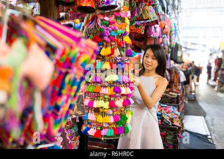 Woman enjoy shopping in weekend market - Stock Photo