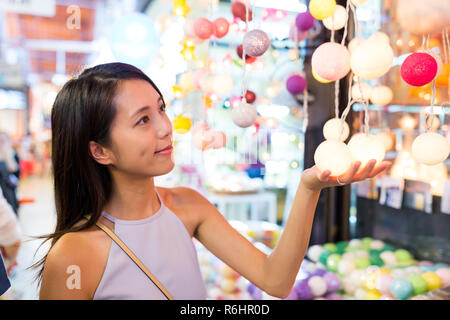 Woman shopping in lamp store - Stock Photo