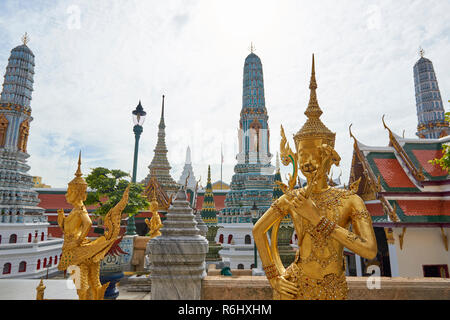 Golden dancer statues inside the Grand Palace in Bangkok, Thailand. - Stock Photo