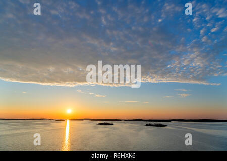 View from deck of the Turku to Stockholm ferry at sunset, Turku Archipelago, Finland - Stock Photo