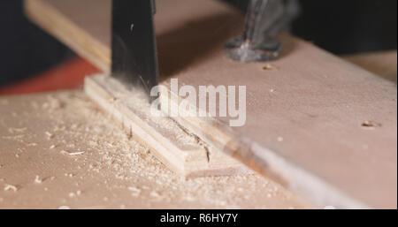Electric jigsaw cutting the wood - Stock Photo