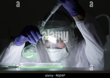 Life scientist researching in bio hazard laboratory. High degree of protection work. - Stock Photo