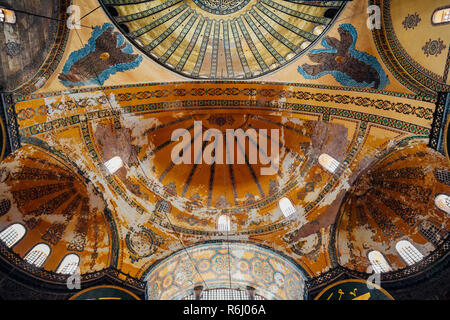 Istanbul, Turkey - August 14, 2018: The dome (ceiling) decoration of the Hagia Sophia Museum, view from inside the temple on August 14, 2018, in Istan - Stock Photo