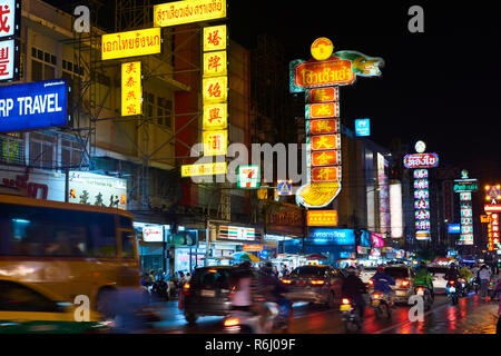 Night shot of Chinatown district in Bangkok, Thailand, with motion blurred traffic and neon signs. - Stock Photo